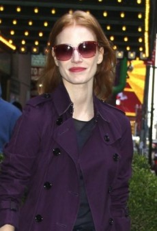 Look of the Day: Jessica Chastain Pairs a Colorful Burberry Trench with Prada Mary Janes