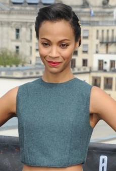 Look of the Day: Zoe Saldana Poses for the Camera in a Cropped Calvin Klein Top and Pleated Skirt