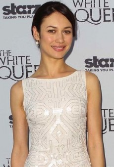 Olga Kurylenko Celebrates The White Queen in a White Lorena Sarbu Dress