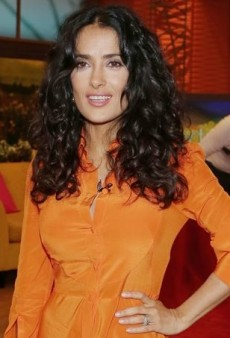Salma Hayek Brightens Up Univision Studios in an Orange Alexander McQueen Dress