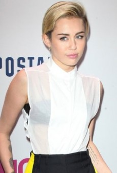 Miley Cyrus Covers Up in a Slightly Masculine Maison Martin Margiela Outfit