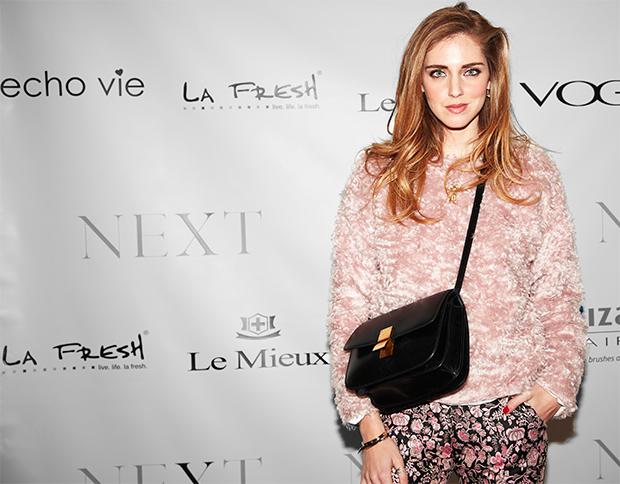 Chiara Ferragni in a pink puffy coat posing on the red carpet