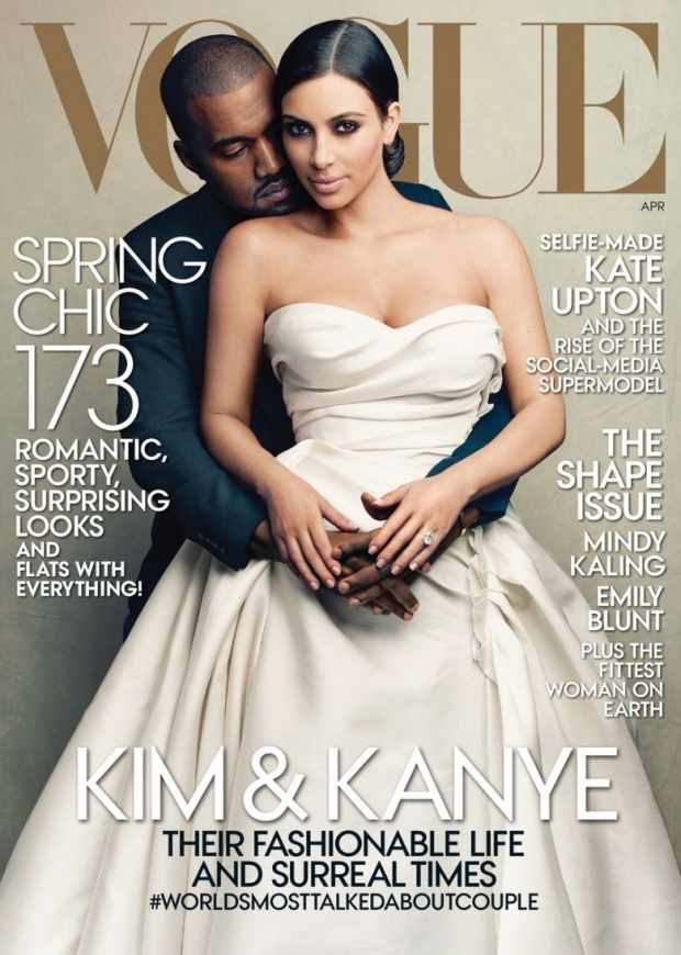 Kanye West wears a tux while holding Kim Kardashian in a wedding gown for Vogue