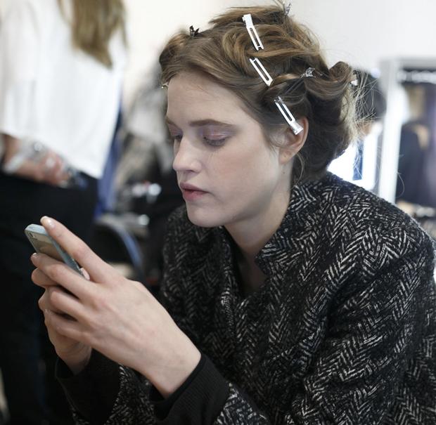 Model cell phone backstage fashion runway show
