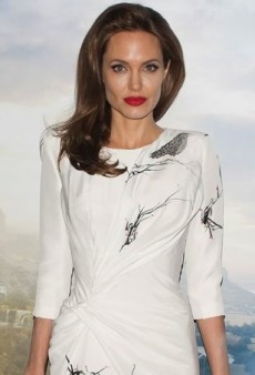 Angelina Jolie Embraces Her Role as Maleficent with Atelier Versace's Raven Print Dress