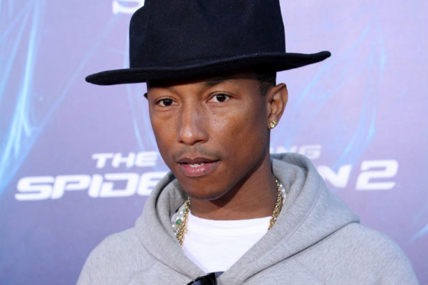 Pharrell Williams pictured in a black hat