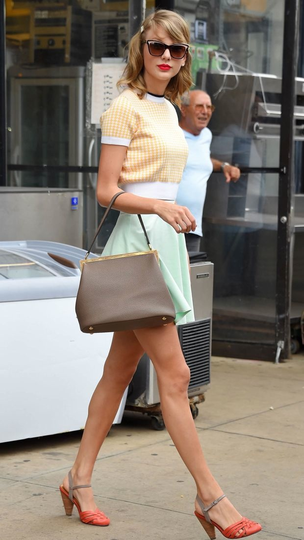 Taylor Swift charms in NYC in a Miu Miu sweater