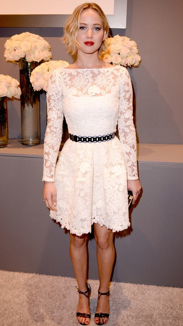 Jennifer Lawrence wears a white lacy Oscar de la Renta dress