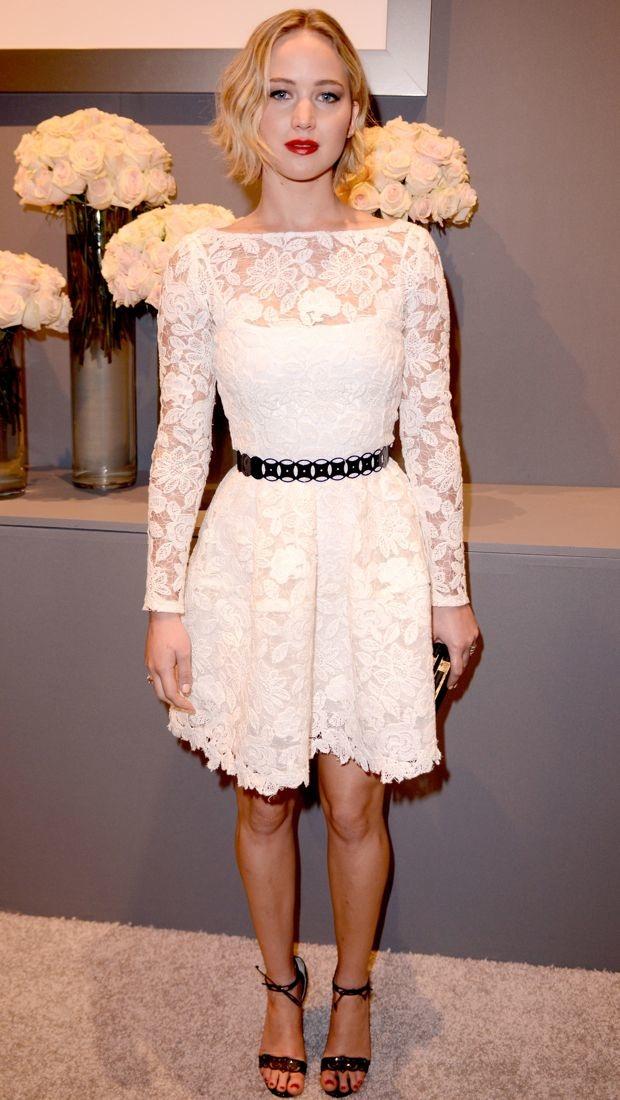 Jennifer Lawrence wears a white lacy Oscar de la Renta dress