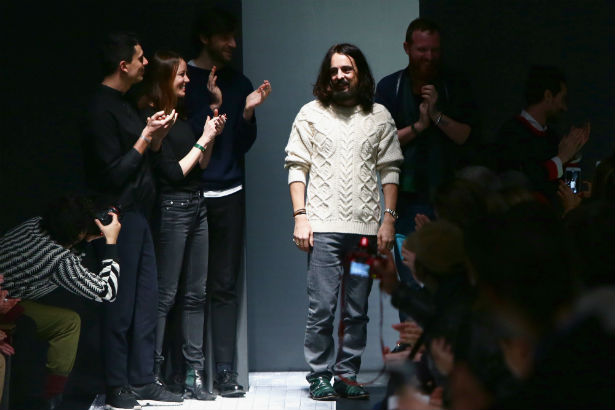 Alessandro Michele closing out a runway show