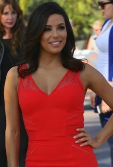 Eva Longoria Visits 'Extra' in a Figure-Flattering Red-Orange Dress