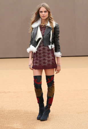Cara wears over-the-knee boots
