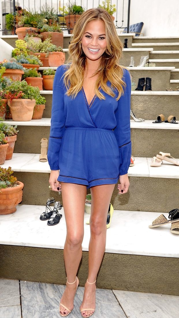 Chrissy Teigen wears a navy Lovers + Friends romper to the RAYE shoe launch