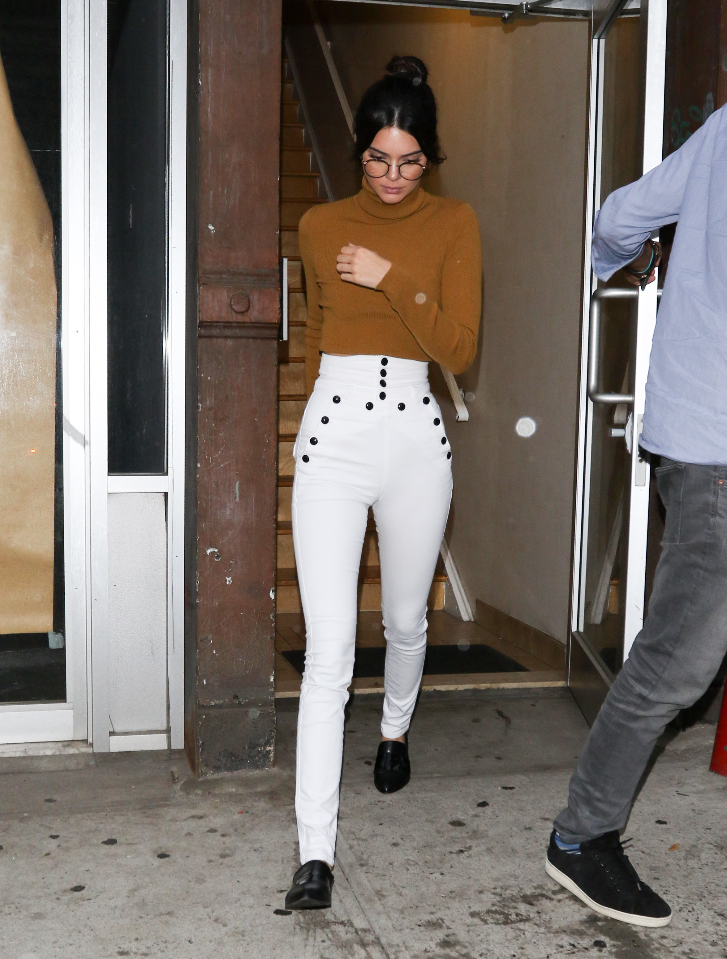 Kendall Jenner is the epitome of geek chic in faux glasses and high-waisted Isabel Marant pants.