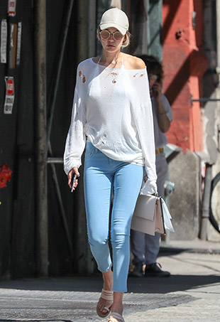 Gigi Hadid strolling through New York in her totes caj dad cap.