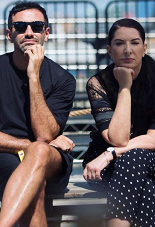 Designer Riccardo Tisci poses with his BFF and creative inspiration, performance artist Marina Abramovic.