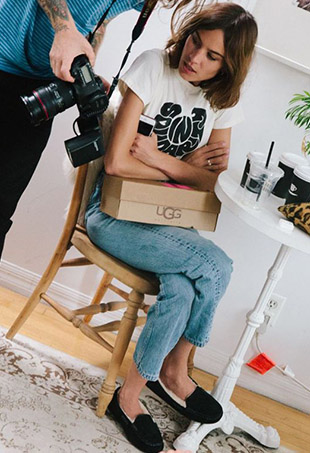 A behind-the-scenes shot of Alexa Chung overseeing UGG's latest campaign shoot.