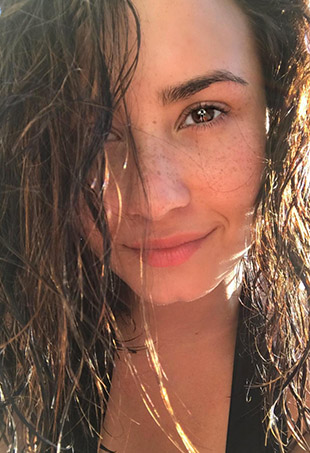 Mental health awareness advocate Demi Lovato poses for a no-makeup selfie.
