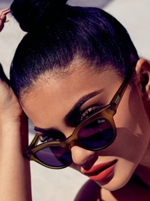 Kylie Jenner in the Quay x Kylie Starstruck sunglasses in Olive Smoke.