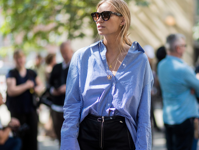 Tine Andrea wears layered pendant necklaces outside Munthe on August 09, 2017 in Copenhagen, Denmark