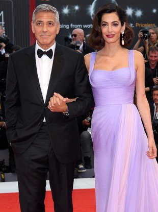 VENICE, ITALY - SEPTEMBER 02: George Clooney and Amal Clooney walk the red carpet ahead of the 'Suburbicon' screening during the 74th Venice Film Festival at Sala Grande on September 2, 2017 in Venice, Italy. (Photo by Venturelli/WireImage)