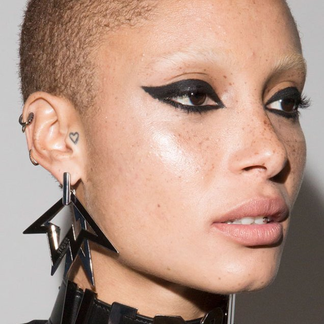 Adwoa Aboah with cat eye at Versus Versace Spring 2018.