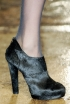 Donna Karan's Black Pony Ankle Booties
