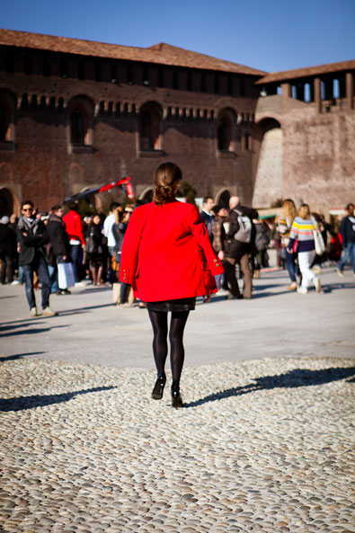A red jacket arriving at the Castello Sforzesco location for Costume National