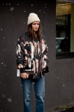 A sweet street look: jeans, jacket and a winter white beanie at the Etro Show