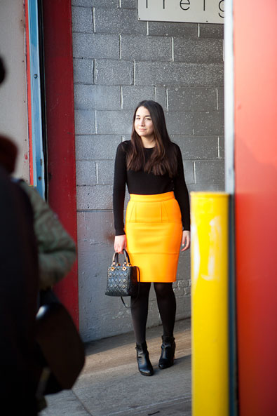 A brilliant orange skirt outside Karen Walker