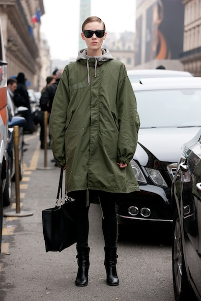 Slick, even in an oversized green military trench