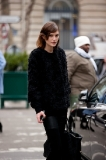 Model leaving Dries Van Noten show, winter blacks