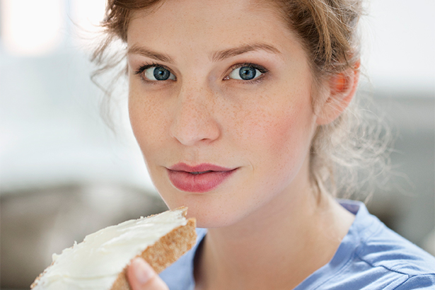 Portrait of a Young Woman Eating Bread / Image: Getty