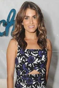 Nikki Reed Checks Out the Backstage Action in Rebecca Minkoff