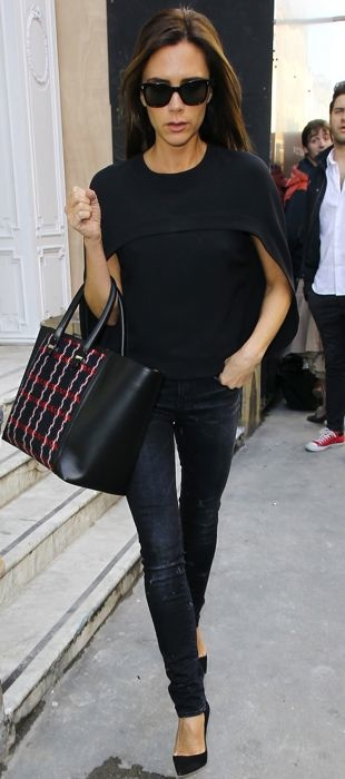 Victoria Beckham in a black Balenciaga cape top in London