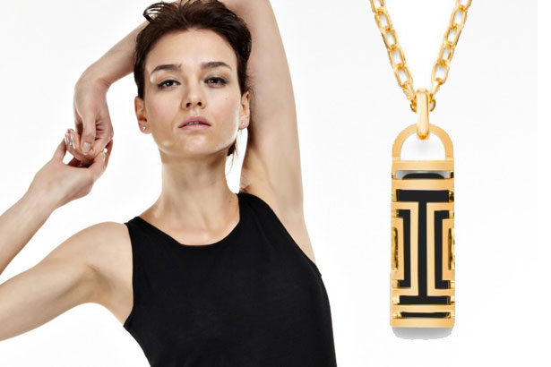Natalia Allen seamless dress and Tory Burch for Fitbit pendant.