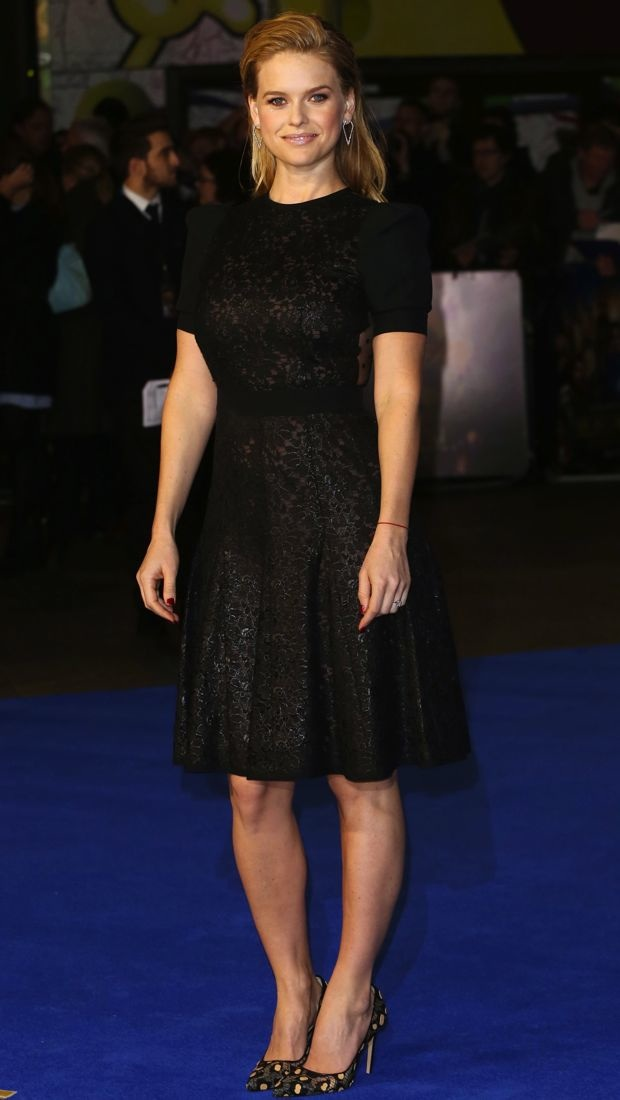 Alice Eve in a black lace Emanuel Ungaro Fall 2014 dress