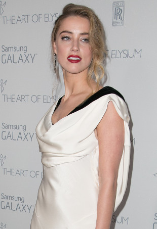 Amber Heard wearing a cowl neck dress.