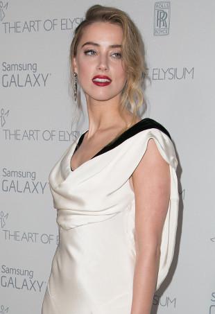 Amber Heard wearing a cowl neck dress.