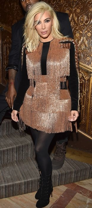 Kim Kardashian in a pink fringe Balmain dress after the Paris Fashion Week Fall 2015 show