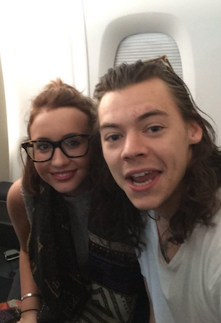 Harry Styles on plane with Alex Lomas