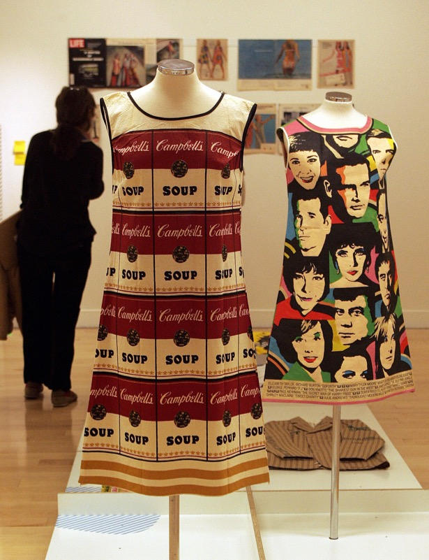 """Athens, GREECE: Paper made Andy Warhol's legendary """"souper dress"""" modelled on Campbell's Soup labels, is showcased next to Universal Studios one titled 'The big ones for 1968' featuring pictures of the popular movie stars, during the exhibition higlihting the pop-mania of sixties , the paper dress, opened in Athens 01 March 2007. The exhibition titled """" RRRIP"""" features also work of other famous designers such as John Galliano, Issey Miyake and others. AFP PHOTO /LOUISA GOULIAMAKI (Photo credit should read LOUISA GOULIAMAKI/AFP/Getty Images)"""