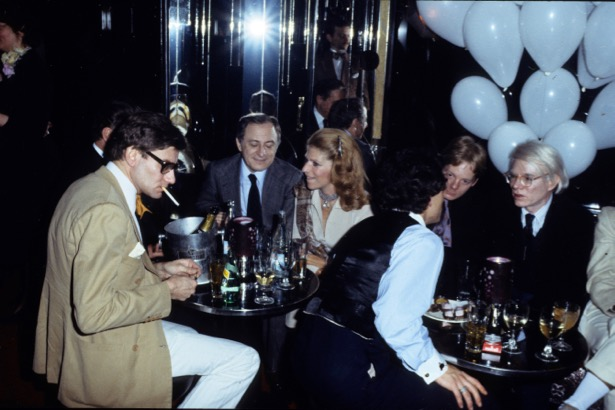 """PARIS, FRANCE - 1977 : Yves Saint Laurent, Pierre Berger, and Andy Warhol at a party in """"le Palace"""" in 1977 in Paris, France.(Photo by Michel Dufour/WireImage)"""