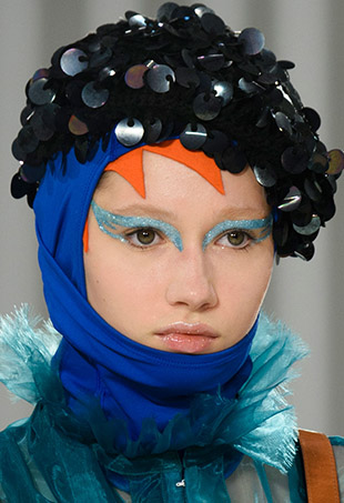 A model walks the Maison Margiela Spring 2017 runway wearing what we suspect to be Pat McGrath's new eye kit.