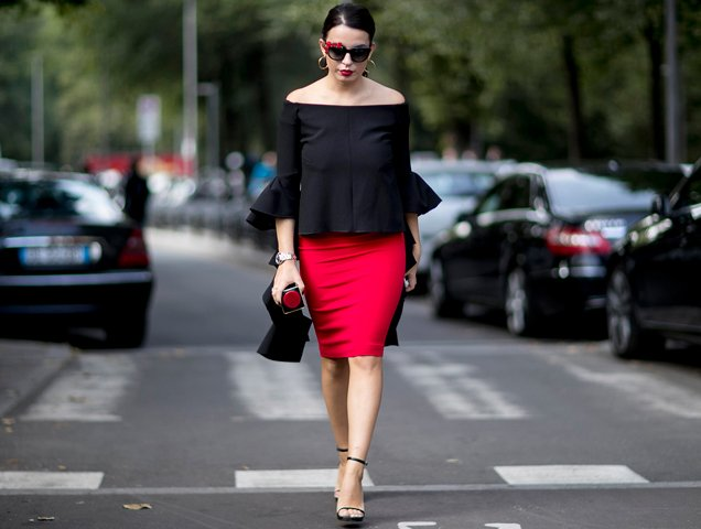 woman with self-confidence wearing black top, red skirt