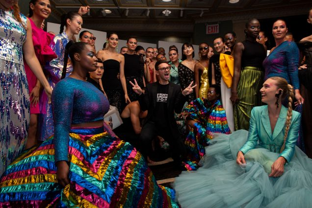Models backstage at Christian Siriano's Spring 2020 show in New York.